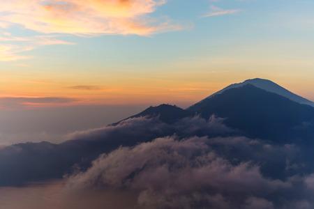 Active volcano Mount Gunung Batur at sunrise in Bali, Indonesia photo