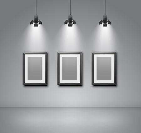 illuminated: Exhibition  wall interior with blank frames illuminated with spotlights. Realistic 3d vector illustration