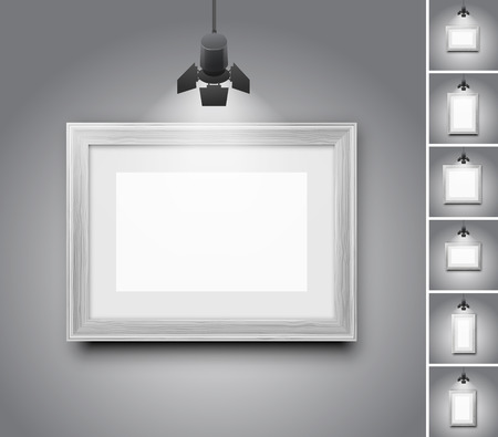 pictures: Blank studio wall and white wooden picture frame under light lamp - set of realistic vector illustrations Illustration