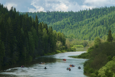 rafters: Rafters in a several rafts on mountains forest river panorama