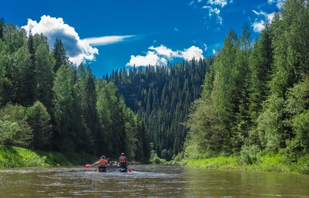 white water: Rafters in a several rafts on mountains forest river panorama