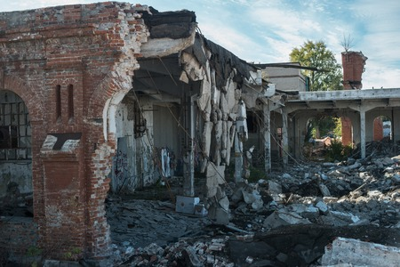 demolish: Crushed building on rotten city district view with survived wall parts Stock Photo