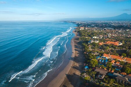 Bali beach aerial view. Denpasar ocean wave shore with many hotel and cafe 版權商用圖片
