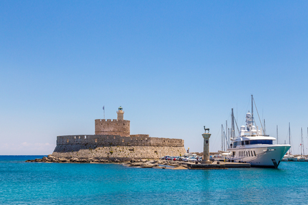 Fort of St. Nicholas and Mandraki port in Rhodes town, Greece Stock Photo