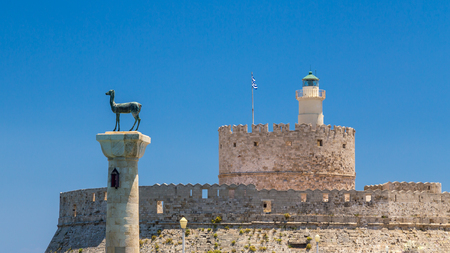 Fort of St. Nicholas and the rhodean deers statues in Mandraki port of Rhodes town, Greece