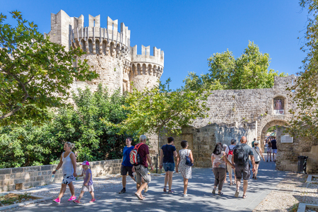 19 JUNE 2017. Tourists in front of the Palace of the Grand Master of the Knights in Rhodes, Greece Редакционное