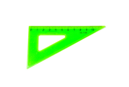 Green triangle ruler isolated on white background