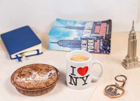 New York concept with cup I love NY, brownie coockie, a book about New York and souvenirs with symbols of New York city