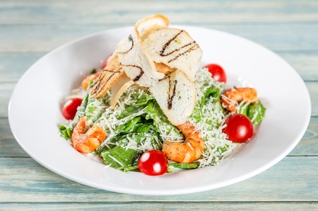 Classic ceasar salad with shrimps  and parmesan cheese