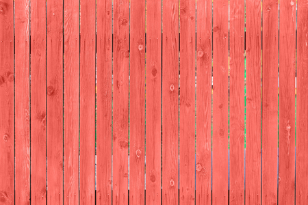 Wooden texture toned to living coral color. Abstract background Imagens