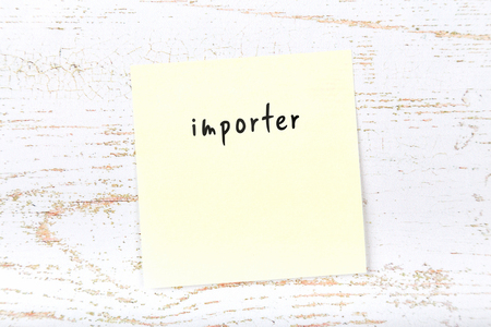 Yellow sticky note with handwritten text importer