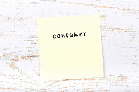 Yellow sticky note with handwritten text consumer