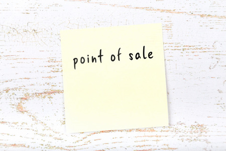 Yellow sticky note with handwritten text point of sale Imagens