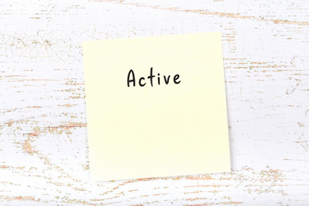Yellow sticky note with handwritten word active