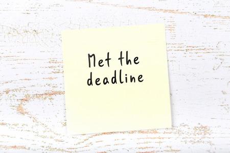 Job interview preparation. Yellow sticky note with handwritten message met the deadline