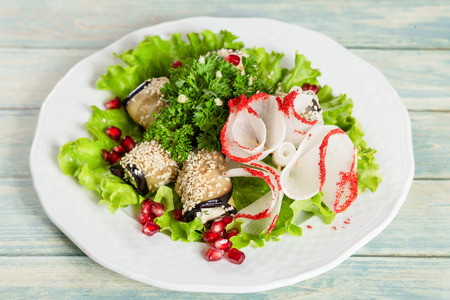 Salad with vegplant rolls and vegetables.