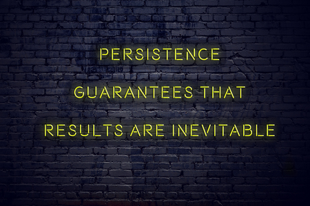Positive inspiring quote on neon sign against brick wall persistence guarantees that results are inevitable. Stok Fotoğraf