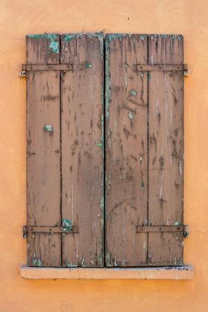Closed retro wooden shutter on a window.