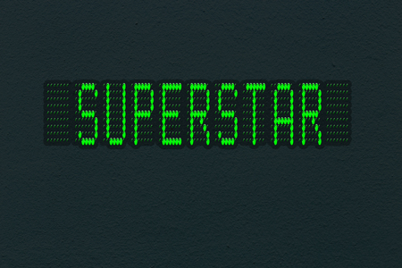 Dark wall texture with LED panel with inscription superstar.