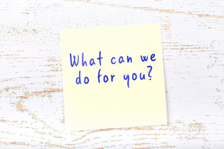 Yellow sticky note with handwritten text what can we do for you.