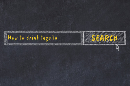 Chalk board sketch of internet search engine. Looking for how to drink tequila. Banco de Imagens