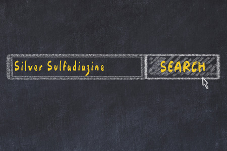Medical concept. Chalk drawing of a search engine window looking for drug silver sulfadiazine.