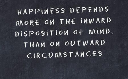 Black chalkboard with handwritten wise motivational quote . Reklamní fotografie