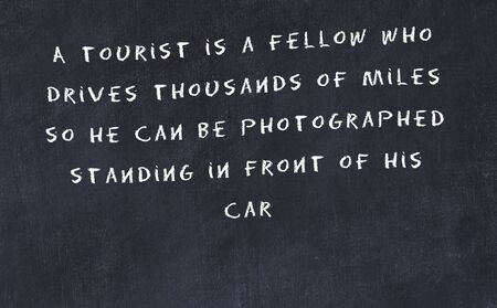 Black chalkboard with handwritten wise motivational quote . Stock fotó