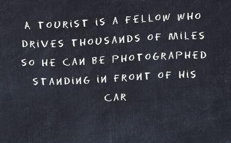 Lavagna nera con citazione motivazionale saggia scritta a mano. Archivio Fotografico