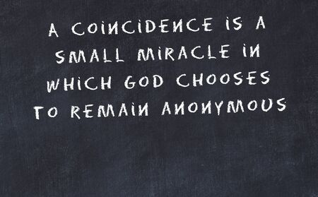 Black chalkboard with handwritten wise motivational quote . Фото со стока