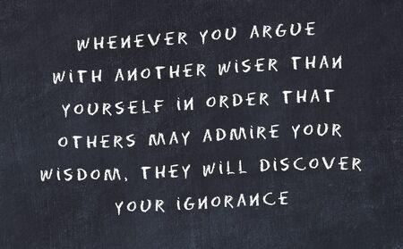 Black chalkboard with handwritten wise motivational quote . Stockfoto