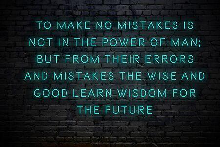 Inscription au néon d'une citation de motivation positive et sage contre le mur de briques. Banque d'images