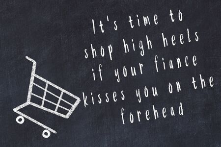 Chalk drawing of shopping cart and short quote about shopping on black board. Stock Photo