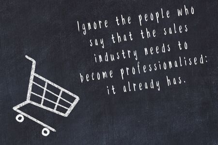 Chalk drawing of shopping cart and short quote about shopping on black board. Stockfoto