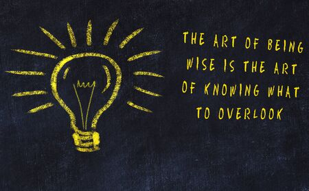 Chalk drawing of bulb and inscription about art and creativity. Stock Photo