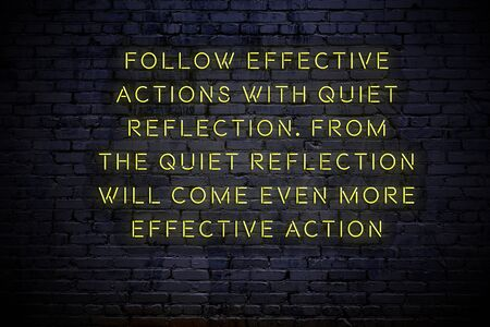 Neon inscription of positive motivational quote on the wall.