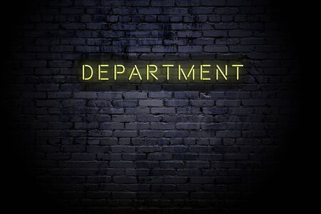 Highlighted brick wall with neon inscription department.