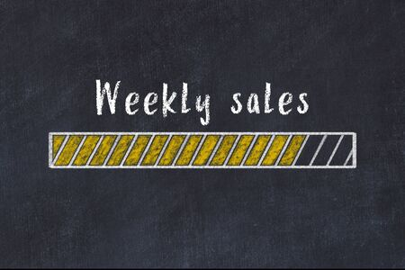 Chalk drawing of loading progress bar with inscription weekly sales. 版權商用圖片