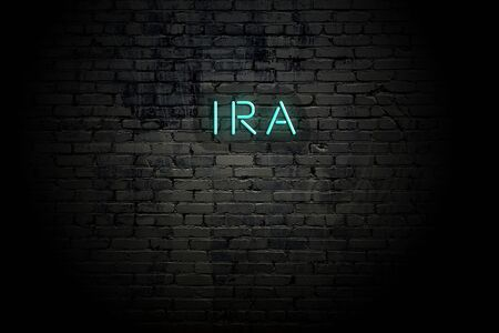Highlighted brick wall with neon inscription ira.