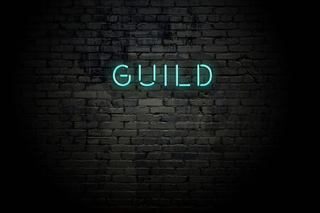 Highlighted brick wall with neon inscription guild.