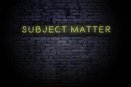 Highlighted brick wall with neon inscription subject matter. Imagens