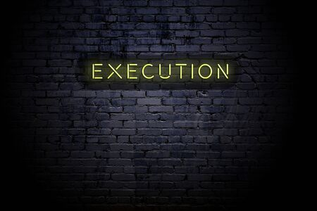 Highlighted brick wall with neon inscription execution.