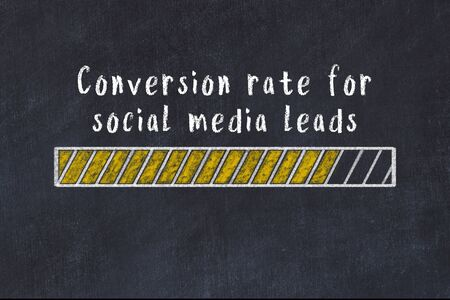 Chalk drawing of loading progress bar with inscription conversion rate for social media leads. Stok Fotoğraf