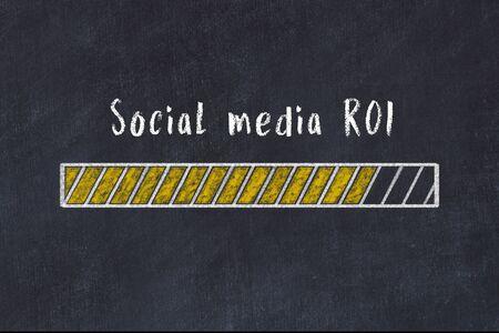 Chalk drawing of loading progress bar with inscription social media roi. Stok Fotoğraf