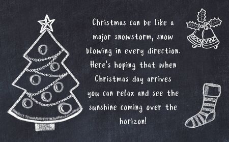 Drawing of christmas tree and handwritten greetings on black chalkboard . Stok Fotoğraf - 131996031