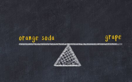 Chalk board sketch of scales. Concept of balance between orange soda and grape. Stok Fotoğraf