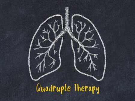 Concept of learning medicine. Chalk drawing of lungs with inscription Quadruple Therapy