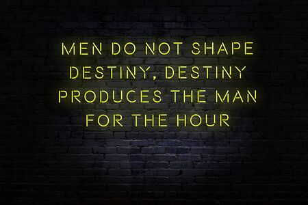 Smart and motivational quotation. Neon sign on brick wall in the darkness Banque d'images