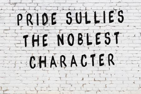 White brick wall with black painted inscription of sensible wise quote on it Stok Fotoğraf