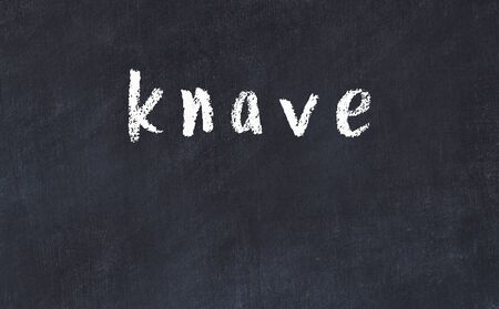 Chalk handwritten inscription knave on black desk Reklamní fotografie
